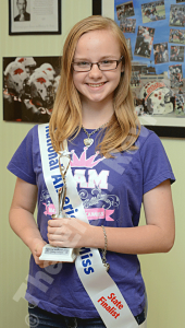 Breanna Carr is pictured with her sash, t-shirt, bracelet and necklace that she wore throughout most of the weekend. She was a state finalist at May's 2015 Miss Nebraska Junior Teen Pageant in Omaha. E- R photo