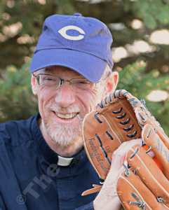 Fr. Ross Burkhalter will wear #3 tomorrow in the I-80 Collar Series softball game. E-R photo