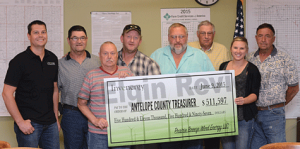 Pictured l-r: Luke Henkle O&M Manager at Prairie Breeze Energy Center in Elgin, Antelope County supervisors Ed Schindler, Jerry Schwager, Neil Williby, Charlie Henery, LeRoy Kerkman, Invenergy LLC Business Development Coordinator Emily Kobylarczyk and supervisor Merlin Bolling.