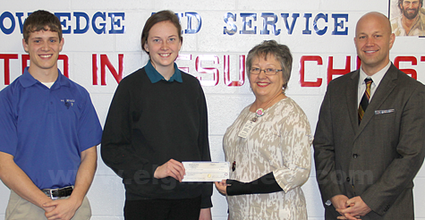 Scott Moser and Terri Seier present the check to Nita Totten and Jake Claussen. Photo submitted