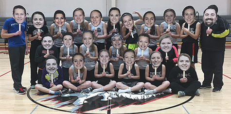 Wolfpack Girls Basketball Team with their big heads.