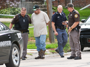 Antelope County Sheriff Bob Moore leads Stacy Colman to a Nebraska State Patrol car following his arrest on Wednesday for violations of the Sex Offender Registry Act. Sheriff Moore and Deputy Timothy Schultz (far right) were assisted by the two members of the Nebraska State Patrol. Elgin Review photo