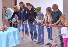 Youth of the St. Bonaventure parish did the ceremonial ribbon-cutting. E-R photo