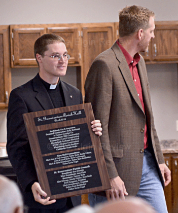 Kelly Kerkman (r) represented the workers on the project and presented a plaque to the parish.