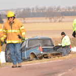 Antelope County Sheriff Bob Moore (with clipboard), the Nebraska State Patrol and members of Elgin Fire & Rescue were at the scene. E-R photo
