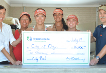Pool staff receive a check from TransCanada.